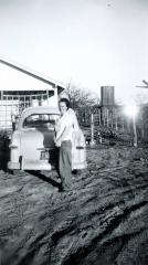 Evalyn Grace Scott in front of house late 1949